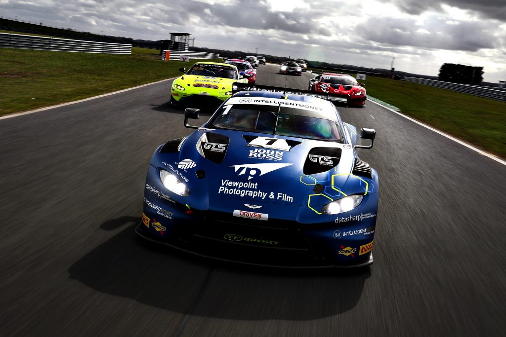 An Aston Martin GT3 car leads a pack of British GT cars in a tracking shot.