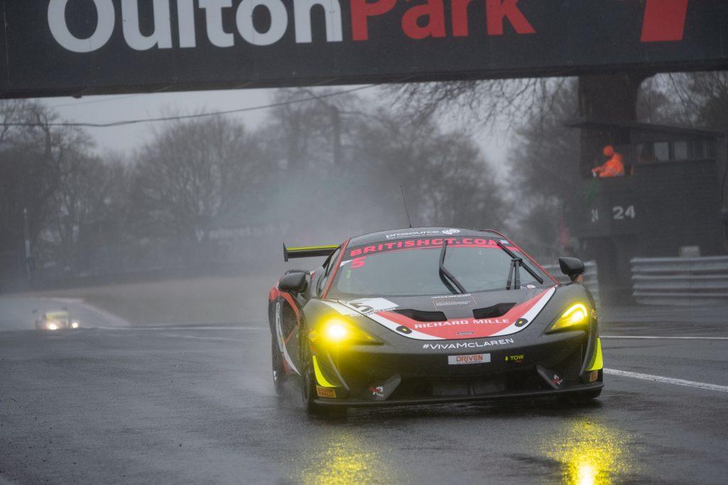 A GT4 McLaren comes to pit lane at Oulton park.