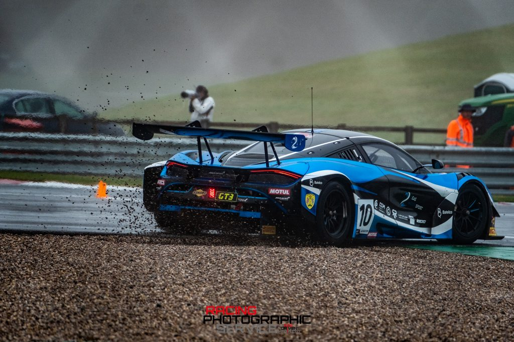 The 2 Seas Motorsport car in the gravel at Foghety Esses at Donington Park.