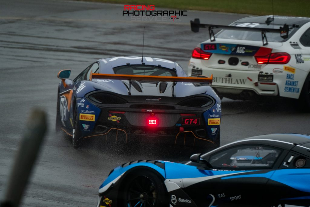 A McLaren racing against other GT cars at Donington Park.