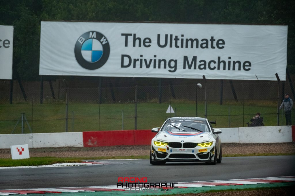 A BMW GT4 car with BMW branding at McLeans on the Donington Park Grand Prix circuit.