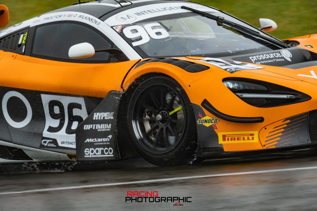 The front tyre of the Optimum Motorsport McLaren shifting water during the British GT Championship at Donington Park.