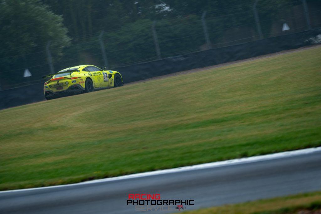 The championship leading TF Sport Aston Martin races at Coppice corner on the Donington Park GP Circuit.