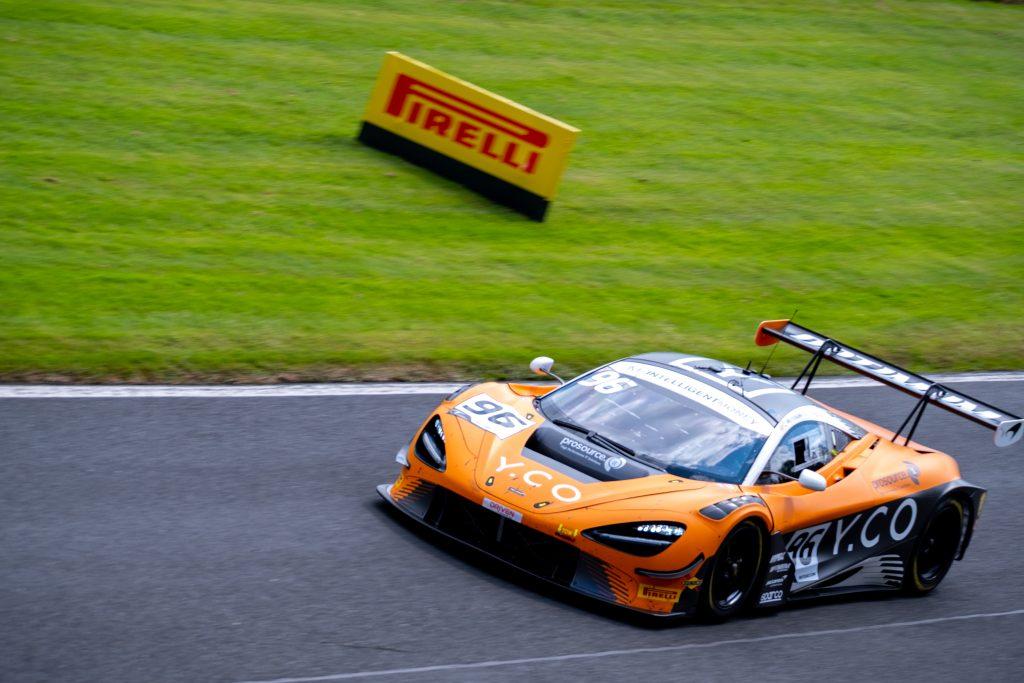 An orange liveried McLaren 720S GT3 goes around the track